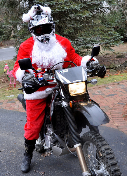 Fuzzygalore Dressed as Santa on the DRZ