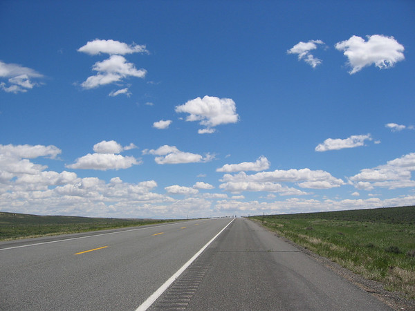 Vast sky on the highway along the prairie