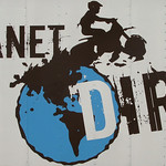 The side of the Planet Dirt motorcycle trailer.