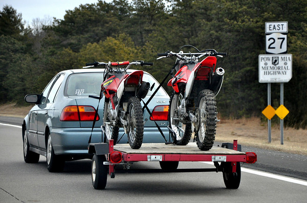 Honda Civic pulling Dirtbikes Trailer